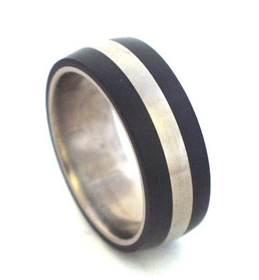 Titanium and Ertalyte ring by Rings & Things