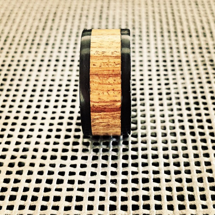 Titanium, Wood and Ertalyte ring by Rings & Things