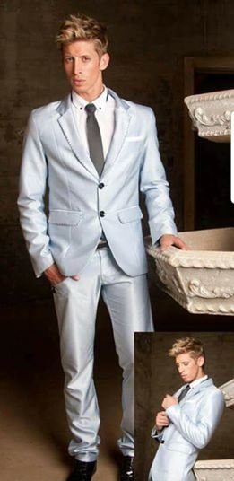YB10: Ice-blue, 2-piece suit, with black stitching detail on lapel and pockets.  by Yihan Brönn Couture